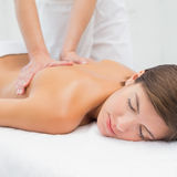 Attractive woman receiving back massage at spa center Stock Photo