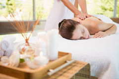 Attractive woman receiving back massage at spa center Royalty Free Stock Photography