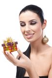 Attractive woman receiving Christmas present. Attractive young woman receiving christmas present, smiling Stock Photos