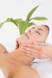 Attractive woman receiving facial massage at spa center Royalty Free Stock Photos