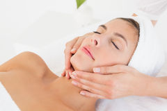 Attractive woman receiving facial massage at spa center Royalty Free Stock Image