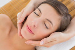Attractive woman receiving facial massage at spa center Stock Images