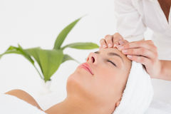 Attractive woman receiving facial massage at spa center Royalty Free Stock Photography