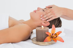 Attractive woman receiving head massage at spa center Royalty Free Stock Image