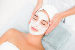 Attractive woman receiving treatment at spa center Stock Photography