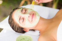 Attractive woman receiving treatment at spa center Stock Image