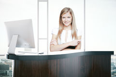Attractive woman at reception desk Royalty Free Stock Photography