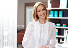 Attractive woman receptionist Royalty Free Stock Images