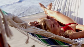 Attractive woman in red bikini in a hammock Royalty Free Stock Photos
