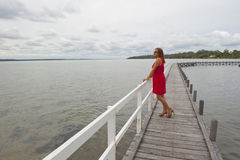 Attractive Woman in Red on Boardwalk Stock Images