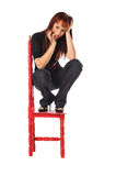 Attractive woman with a red chair Stock Photography
