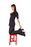 Attractive woman with a red chair Royalty Free Stock Image
