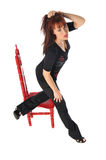 Attractive woman with a red chair Royalty Free Stock Photos