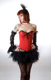 Attractive woman in red corset and black skirt Stock Photos