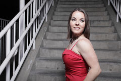 Attractive woman in a red dress Stock Image