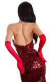 Attractive woman in a red dress is back Stock Image