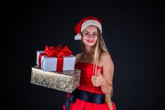 Attractive woman in red dress and hat holding gift box isolated Royalty Free Stock Images