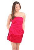 Attractive woman in a red dress posing Royalty Free Stock Image