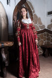 Attractive woman in red dress in retro baroque Royalty Free Stock Photo