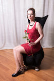 Attractive woman in red dress with rose Royalty Free Stock Photography