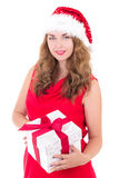 Attractive woman in red dress and santa hat with christmas prese Stock Photography