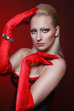 Attractive woman in a red gloves Royalty Free Stock Photos