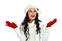 Attractive woman with red gloves looking up with raised hands Stock Photos