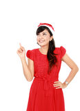 Attractive woman in red pointing up Royalty Free Stock Photo