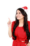 Attractive woman in red pointing up Stock Photography