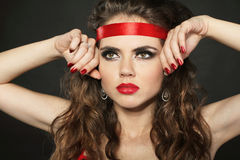 Attractive woman with red ribbon on the head Stock Image
