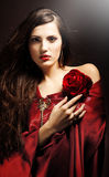 Attractive woman with red rose Royalty Free Stock Images