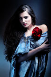 Attractive woman with red rose Stock Photos