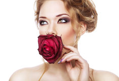 Attractive woman with red rose. On white background Stock Image