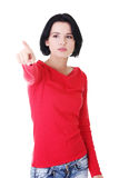 Attractive woman in red tshirt pointing up. Royalty Free Stock Photo