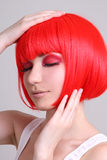 Attractive woman in red wig Royalty Free Stock Photos