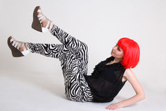 Attractive woman in red wig Stock Image