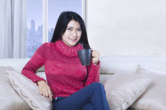 Attractive woman relax with hot tea Stock Photography