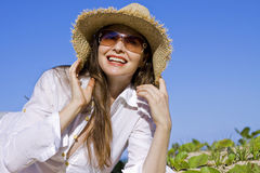 Attractive woman relaxing at the beach Royalty Free Stock Photography