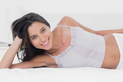 Attractive woman relaxing in bed Stock Photography