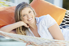 Attractive Woman Relaxing In Garden Hammock Stock Photography