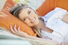 Attractive Woman Relaxing In Garden Hammock Stock Image