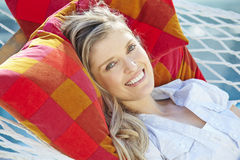 Attractive Woman Relaxing In Garden Hammock Royalty Free Stock Photography