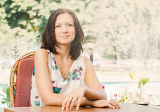 Attractive woman relaxing in the garden Royalty Free Stock Images