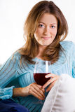 Attractive Woman Relaxing With A Glass Of Wine Royalty Free Stock Images