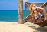 Attractive woman relaxing in a hammock Stock Image
