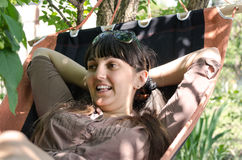 Attractive woman relaxing in a hammock Stock Images