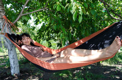 Attractive woman relaxing in a hammock Royalty Free Stock Photo