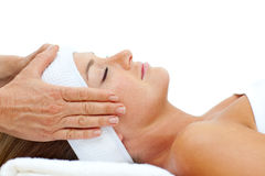 Attractive woman relaxing with head massage Stock Image