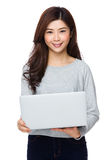 Attractive woman relaxing with her laptop Royalty Free Stock Images
