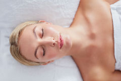Attractive woman relaxing on a massage table Royalty Free Stock Photography